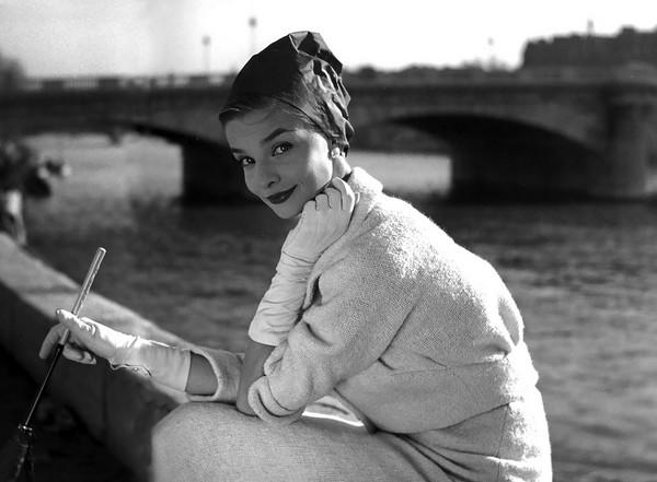 Iris Bianchi sitting along the Seine ELLE, 1957