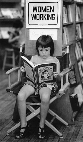 Tara MacNeil reading wonder woman at New Words Bookstore Cambridge MA 1976